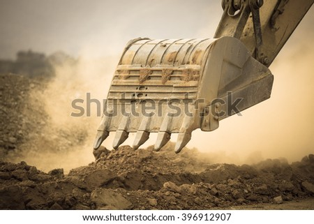 Excavator working with red soil and dusty - stock photo