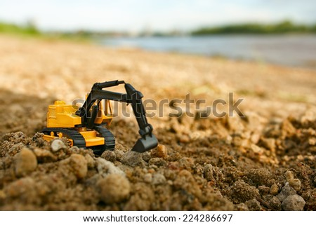 excavator works on the river bank - stock photo