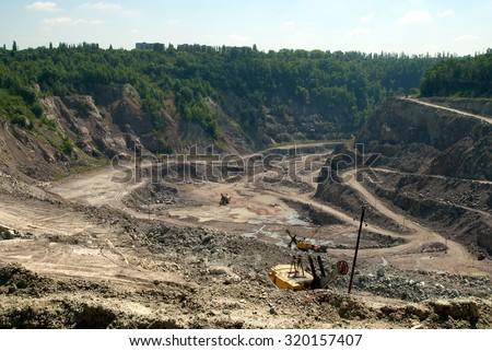 Excavators at open Quarry site - stock photo
