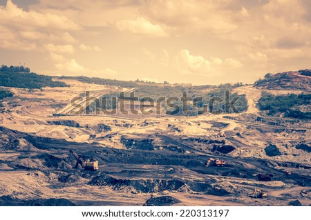 excavators at work in the open-pit mine - stock photo