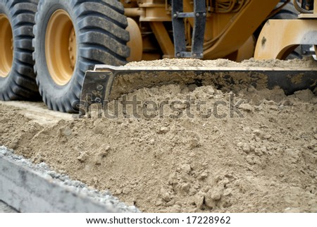 Excavators Clearing Sand For Roadworks - stock photo