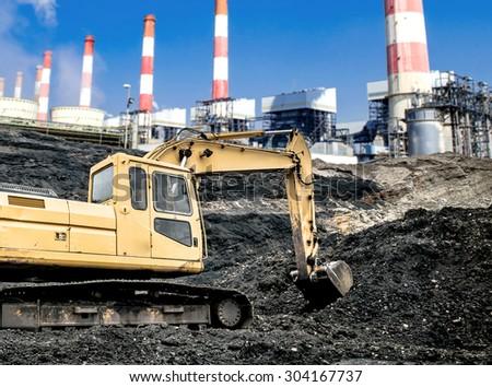 Excavators in coal mines. - stock photo