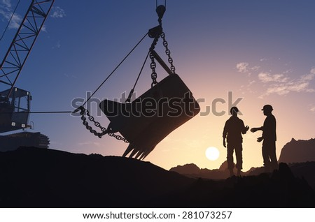 Excavators working in the quarry. - stock photo