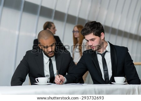 Excellent business cooperation . Two young motivated successful business partners are on the business meeting. Business meeting concept. African businessman - stock photo