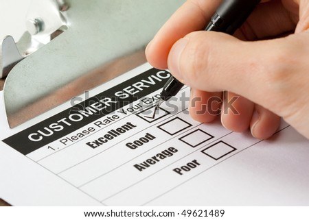 Excellent experience check box in customer service survey form - stock photo