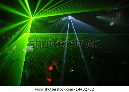 Excellent laser party at the club. - stock photo