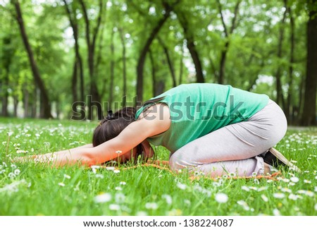 Excercising at park in beautiful spring day - stock photo
