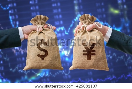 Exchange currency concept. Hands hold bag full of money - Dollar and Yen. - stock photo