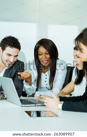 Exchange of thoughts during a business brainstorming by happy colleagues - stock photo