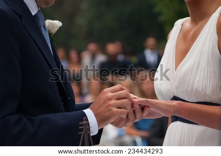 exchange of wedding rings during the cerimony - stock photo