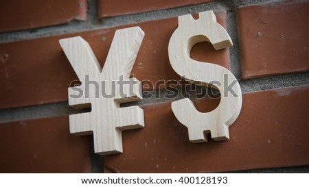 Exchange rating. Currency sign Yen, Dollar on brick wall - stock photo