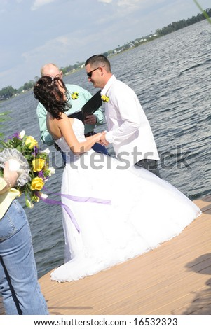 exchanging vows on the water - stock photo