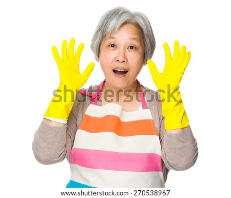 Excite housewife with plastic gloves and raise hand up - stock photo