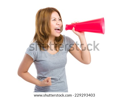 Excite woman shout with megaphone - stock photo