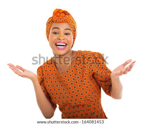excited african woman in traditional clothes isolated on white - stock photo