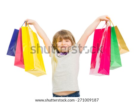 Excited and enthusiastic young shopping girl on white background - stock photo