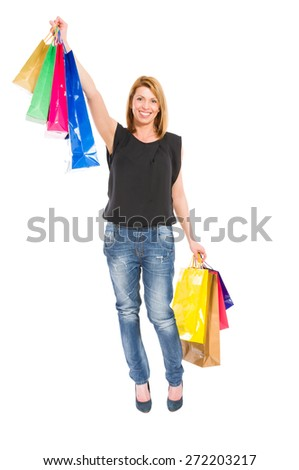 Excited and smiling shopping woman standing isolated on white background - stock photo