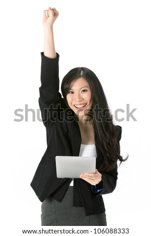 Excited Asian business woman using touchpad pc and cheering. - stock photo