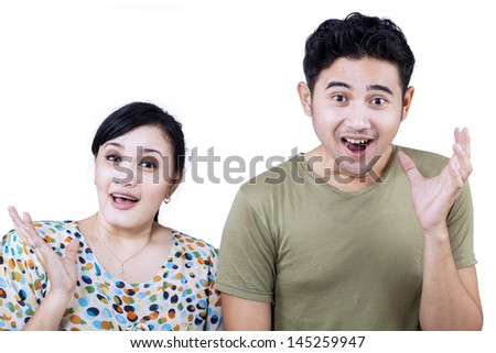 Excited Asian couple expression on white background - stock photo