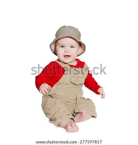Excited baby explorer/farmer sits on white background looking at camera - stock photo