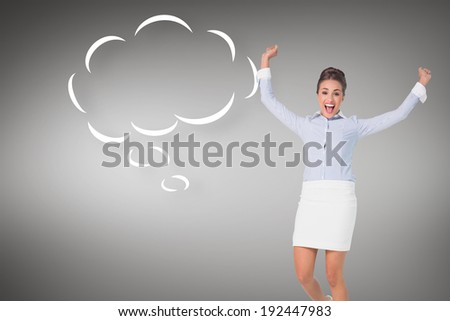 Excited brunette businesswoman jumping and cheering with speech bubble against grey vignette - stock photo