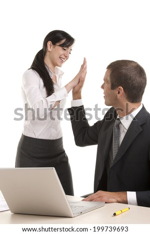 Excited business people giving high-five - stock photo