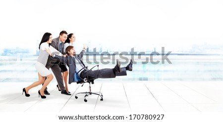 excited business people group team push colleague leader sitting in chair, young businesspeople smile raised hands arms, concept of human resources - stock photo