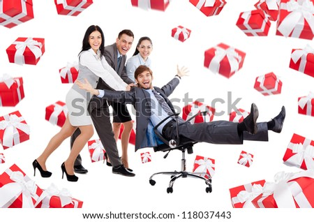 excited Business people group team push man leader colleague sitting in chair, gift box presents fall fly around, young businesspeople smile, Isolated over white background - stock photo