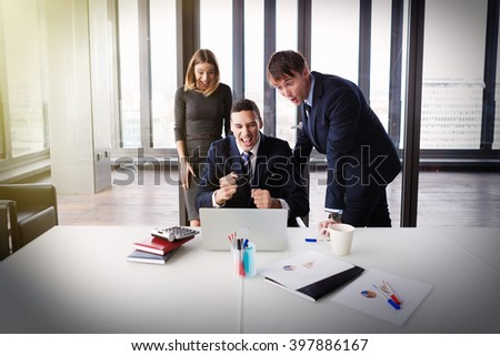 Excited business people in modern office working on project. Post processed with film and sun filter. - stock photo