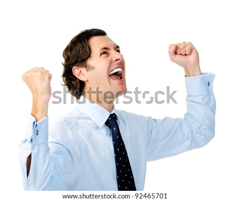 Excited businessman celebrates by pumping fists - stock photo