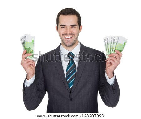 Excited businessman holding euro notes. Isolated on white - stock photo