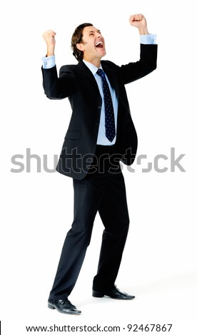 Excited businessman pumps both fists in the air in a celebratory gesture - stock photo