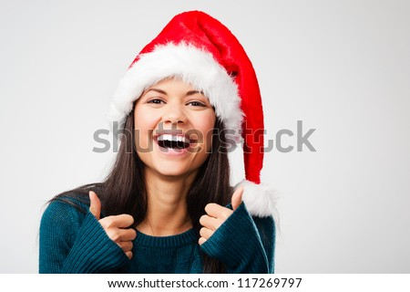 excited christmas woman celebrating and cheering for seasonal holiday isolated on grey background - stock photo