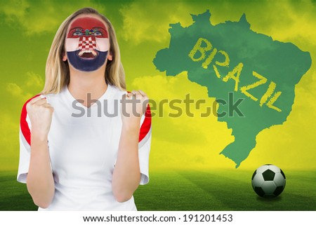 Excited croatia fan in face paint cheering against football pitch with brazil outline and text - stock photo