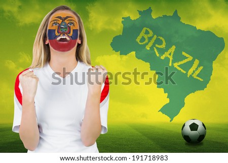 Excited ecuador fan in face paint cheering against football pitch with brazil outline and text - stock photo
