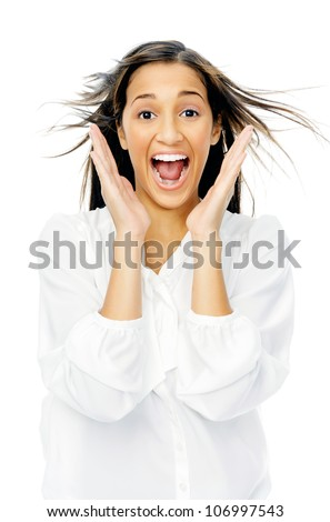 Excited facial expression of shock and surprise woman with hands up and hair blowing isolated on white background. - stock photo