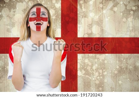 Excited fan england in face paint cheering against england flag in grunge effect - stock photo