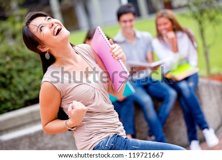 Excited female student celebrating the end of the school year - stock photo