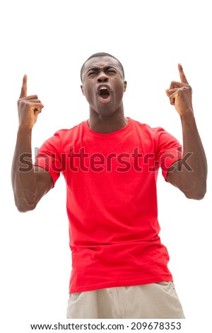 Excited football fan in red cheering on white background - stock photo