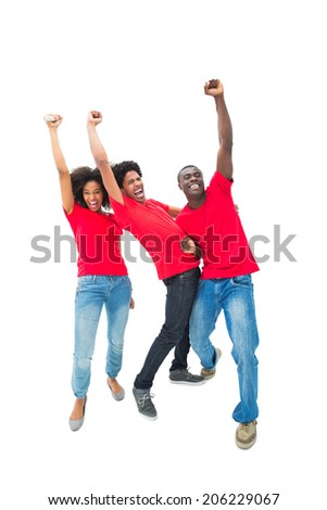 Excited football fans in red cheering on white background - stock photo