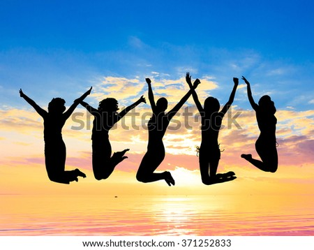 Excited Friends Silhouettes  - stock photo