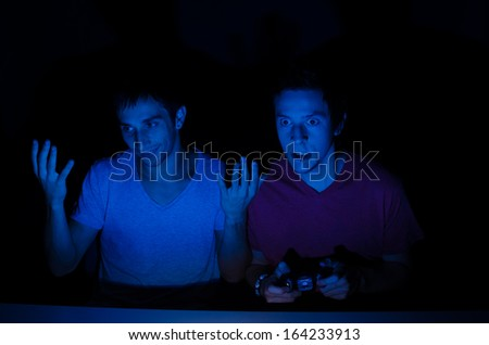 Excited gamer about to loose it in front of the screen - stock photo