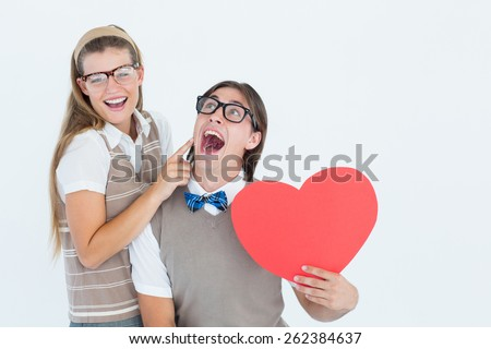 Excited geeky hipster and his girlfriend on white background - stock photo