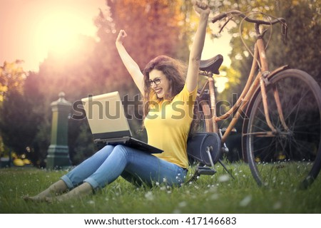 Excited girl at the park - stock photo