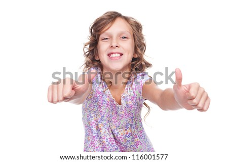 excited girl showing thumbs up and laughing. isolated on white background - stock photo