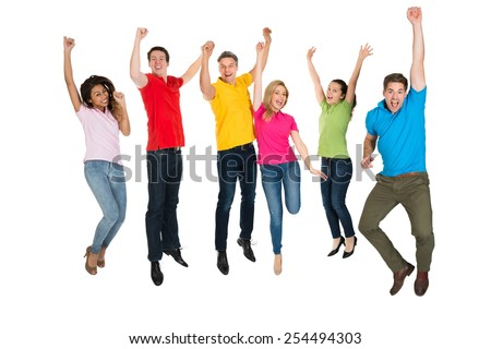 Excited Group Of Multiethnic People Jumping Over White Background - stock photo