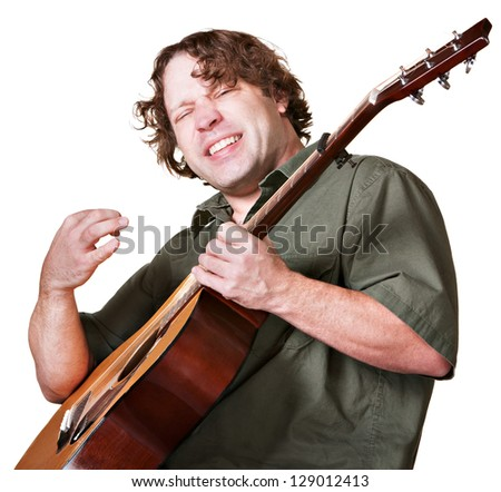 Excited guitar player strumming his instrument on white background - stock photo