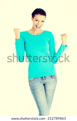 Excited happy success young woman with fists up, isolated - stock photo