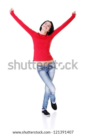 Excited happy young woman with fists up, isolated - stock photo