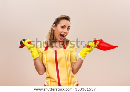 Excited housewife is ready for cleaning.Excited housewife - stock photo